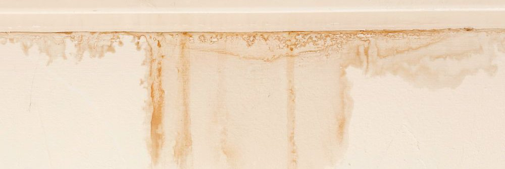 Water stains on a wall indicating a water leak needing repair.
